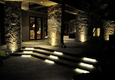 Recessed LED light fixtures illuminate the steps up to this beautiful patio area, accented by strategically spaced uplights. Superbrightleds.com offers a wide variety of products to help you achieve this look.    (Outdoor landscape patio and deck ligthing)