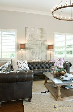 Amanda Carol Interiors. Crest Court project. Leather chesterfield sofa, abstract art, zebra hide