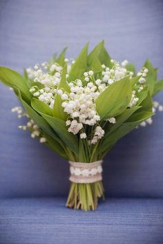lace wrapped lily of the valley bouquet