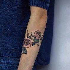 Cute colored rose arm tattoo