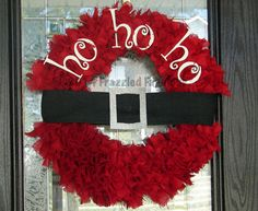 This wreath is hand cut and hand tied from strips of red burlap. It measures 24 across. The letters are wood and are painted white with glitter. The belt is constructed from black burlap and is decorated with a glittery belt buckle.
