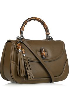 Gucci - olive leather shoulder bag with bamboo handle, turn-lock closure and tassel wraps.