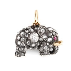 A FABERGÉ SILVER, GOLD AND DIAMOND MINIATURE PENDANT, WORKMASTER AUGUST HOLLMING, ST. PETERSBURG, CIRCA 1890 in the form of an elephant, set throughout with rose-cut and circular-cut diamonds, the eyes with rubies
