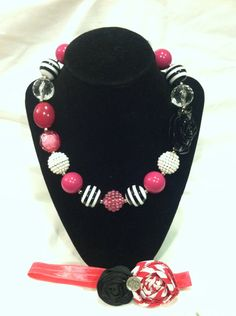 Hot pink and black chunky bubblegum necklace with matching headband on Etsy, $19.99