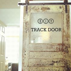 #DIY Do-it-yourself TRACK DOOR tutorial on how to create your own track doors. Inexpensive. Sexy. Awesomeness.