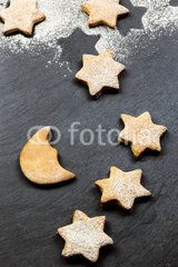 starry sky made by delicious cookies over slate background