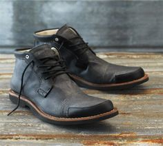 Black boots, distressed for casual wear. Interesting detail without being…
