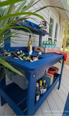 an outdoor potting table can be turned into the patio outdoor bar cart! Check out this one from http://www.heatherednest.com what a fun use for this type of piece!! from http://Wayfair.com (affiliate)