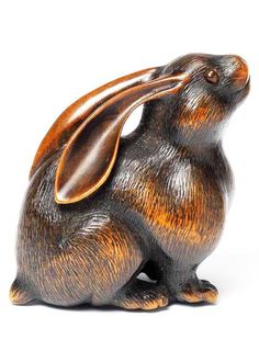 A fine Wood Netsuke of a female hare by Naito Toyomasa, Tanba, early 19th century