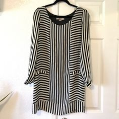 Forever 21 striped dress. Love 21 black and white striped dress. Lined inside.  Size XS. Pair it with black tights for the winter or Xmas party or wear it black pumps for a wedding or date. Never worn. Shell: 100% silk, lining: 100% polyester. Dry clean only. Forever 21 Dresses