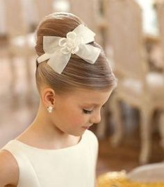 flower girl updo hairstyle with bow