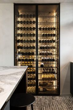 Wine storage with Ceppo di Gre wall by Potier Stone - Wille Offices in Knokke Be. Wine storage with Ceppo di Gre wall by Potier Stone - Wille Offices in Knokke Belgium Glass Wine Cellar, Home Wine Cellars, Wine Cellar Design, Wine Cellar Modern, Wine Shelves, Wine Storage, Storage Ideas, Kitchen Storage, Storage Design
