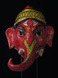 North India 15.5 in, papier mache  Ganesh, the popular elephant-headed god, is (on this mask) equipped with a mouth that moves up and down. How could you not like this deity who removes all obstacles through bestowing wisdom. Condition is good-- though I can't figure out how to make the mouth work.  It was formerly part of a collection of Ms Sharon Lowen, the well-known performer, scholar and writer of Indian traditional dance.