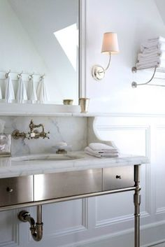 I've noticed I like when vanities have the marble backboard?