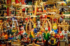 Brightly-colored smokers, nutcrackers and wooden toys at the German Christmas markets
