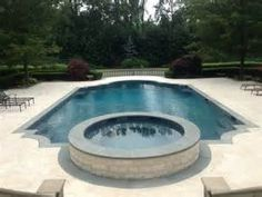New Roman End Pool with Raised Spa and Marble Pavers