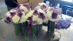 Some very nice white and purple bridesmaid's bouquets made by DIYers today.  The vases they are in are wrapped with a Tea Leaf on the inside.  A very nice look.