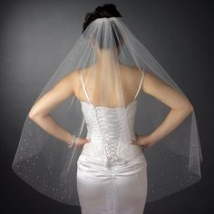 "Single layer fingertip length bridal veil with a cut plain edge with scattered multi-sized swarovski rhinestones throughout the veil Size: 36"" long V 2221 1F"