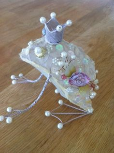 The frog prince; use costume jewelry on a cloth frog