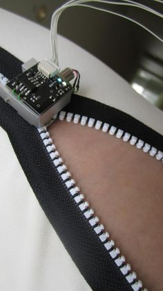 The Zipperbot uses optical sensors to properly mesh the zipper teeth and motion sensors to zip and unzip at the right time.