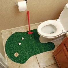 This putt trainer is perfect for golfers who can't take time out from practice, even for a bathroom break! More fun than reading! For the most dedicated golfer...The Clubhouse Collection Bathroom Golf Game includes a contoured polyester putting green, plastic putter, two plastic golf balls, and a plastic flag. Makes the perfect gift for your favorite golfer! #bathroomhumor #helovesgolf
