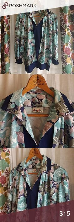 Vintage long sleeve leisure floral blouse sz 10 MD Vintage long sleeve leisure floral blouse sz 10 medium  100% polyester, 70s or 80s leisure wear. Navy blue trim and accents with rose pattern  Thanks for looking!! Item is preowned and sold as-is, no refunds. Please review photos carefully. Please feel free to ask questions! tops n tops Tops Blouses