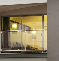 Frameless Glass Balustrade    Stainless steel handrails with frameless glass infill panels are a fantastic way to provide elegant safety without obstructing views.    www.balustradedesign.com.au