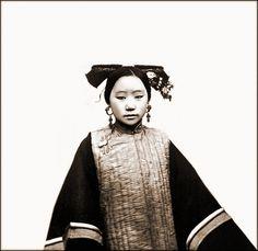 Example Of A Coiffure On A Tartar Or Manchu Female, Frontview, Peking, Pechili Province, China [1869] John Thomson