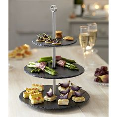 Handcrafted from food-safe coated slate, this cake stand a unique serving piece for the girl that loves to entertain. Add a matching serving tray to round out the table at all her future parties.  Where to get it: Stocked in steel at Perlora South Side, $99