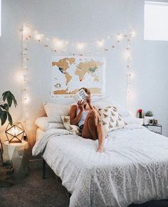world map above the bed, amd the lights