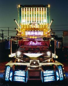 """The Dekotora or Decotora an abbreviation for """"Decoration Truck"""", is a kind of loud and flashy decorated truck most commonly found in Japan. Las Vegas Slots, House Paint Interior, Interior Design, Big Rig Trucks, Semi Trucks, Truck Art, Thing 1, Nose Art, Skateboard Art"""