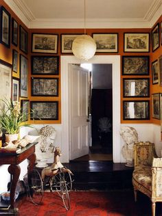 Pickering Forest's inner hall [County Kildare-Ireland] gallery walls and adorable antique settee