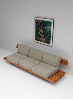 The slats that this couch is on making it look like it floats.  Clean, crisp minimalist design.