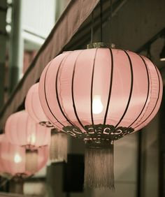Pretty pink lanterns . . . for a very feminine porch.