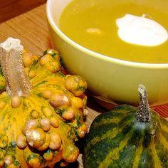 Pumpkin soup with potatoes, leek and prawns