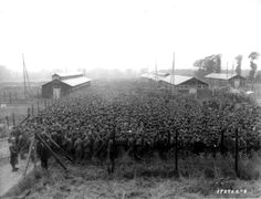 German POWs packed into the Nonant le Pin prisoner camp after being captured in the Falaise Pocket, 1944. [3243x2480]