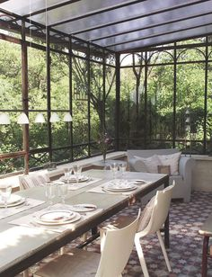 What I like: tile floor; black framed windows; seating; dining