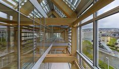 Seven-story office building in Zurich with _no_ structural steel, just precision-milled laminated wood beams. So innovative.