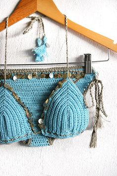 Handmade crochet sliding triangle top and bottom, embellished with shine shells. Reminiscent of found objects washed ashore. Tassel detail on strings. Hand crochet. Turquoise color with grey trimming.  Cotton/viscose blend yarn.  Retro, boho chic style. Sure to be a favorite on the beach or at the pool. The bra cups and the bottom are well shaped and adjustable due to the cords to bind, so you can adjust it how you need. The bottom is Brazilian style, but can be modified !  You can get w...