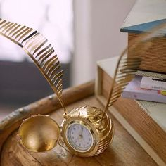 Time will fly away from you with this Golden Snitch clock!