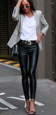Gray blazer over white tee and black leather jeans.