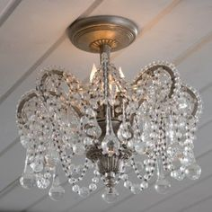 24 light chandelier with small clear glass flowers on positionable wires