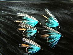 Tying a Teal Blue & Silver (Wet Fly) with Davie McPhail.