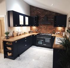 From exposed brickwork to navy kitchen cabinets, this Fairford Navy kitchen is packed with kitchen design inspiration. Pair the navy shaker ideas with wooden worktops and grey flooring ideas. Home Decor Kitchen, Kitchen Interior, New Kitchen, Brass Kitchen, Kitchen Oven, Kitchen Ideas, Kitchen Hardware, Kitchen Storage, Wooden Worktop Kitchen