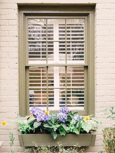 Install Window Boxes in 11 Budget-Friendly Ways to Boost Curb Appeal from HGTV