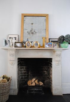 Katharine & James' Glamorous Family Home in London House Tour | Apartment Therapy - fireplace