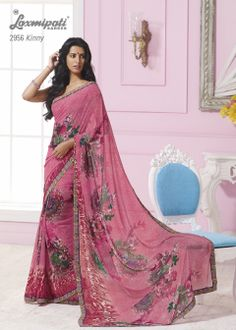 This raspberry  red georgette material saree with multi color border & with beautiful flowers prints.