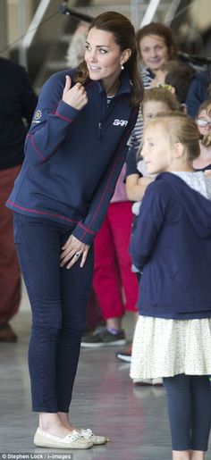 Kate is seen chatting with families at the new Ben Ainslie Racing headquarters