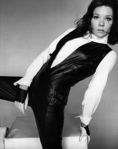 Diana Rigg plays Emma Peel in the TV series The Avengers - she was kicking it back in the 60's.