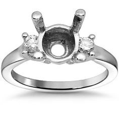 This elegant womens diamond engagement ring setting is crafted in lustrous 14K white gold. The two round cut side stones are G in color and VS in clarity and total to 0.35 carats. The prong measures to 1/4 inches in width and the frame weighs approximately 5.6 grams. $712